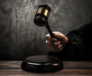 http://www.dreamstime.com/stock-images-judge-s-hammer-holding-wooden-image34645014
