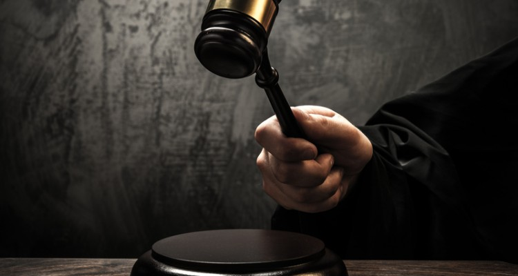 http://www.dreamstime.com/stock-images-judge-s-hammer-holding-wooden-image34645014